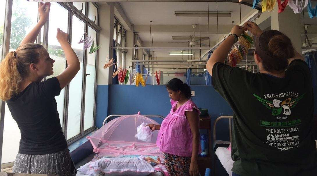 A group of interns from Projects Abroad are seen decorating the childrens room at a local hospital whilst on their midwifery internships in Sri Lanka.